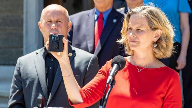 Nassau County Executive Laura Curran holds a police