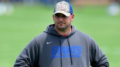 Giants head coach Joe Judge watches practice during