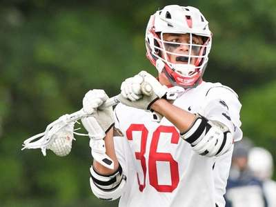AJ Alexander of Syosset looks for aa pass