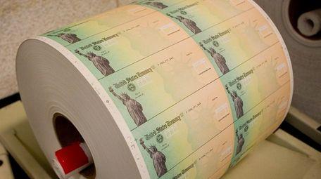 Economic stimulus checks are prepared for printing at