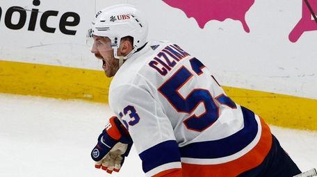 New York Islanders' Casey Cizikas celebrates his winning
