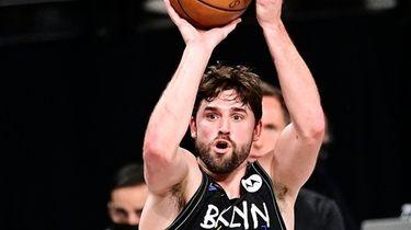 Joe Harris #12 of the Brooklyn Nets attempts