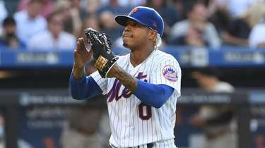 Mets starting pitcher Marcus Stroman reacts as he