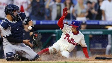 Ronald Torreyes #74 of the Philadelphia Phillies scores