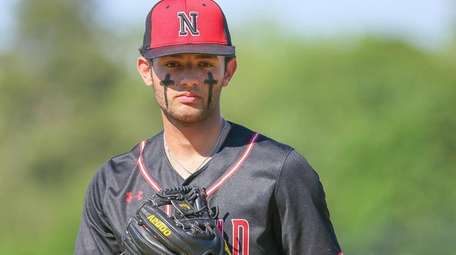 Newfield's Dylan Johnson pitches against Hauppauge on June