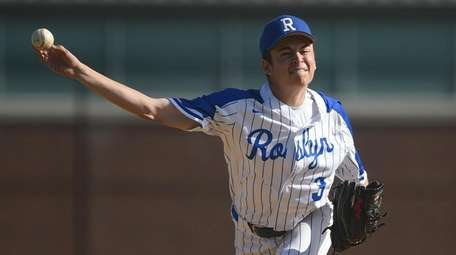 Hayden Leiderman #3, Roslyn pitcher, delivers to the