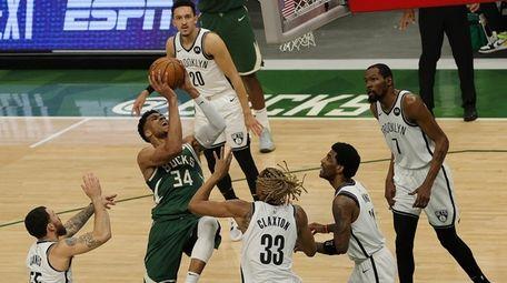 Giannis Antetokounmpo #34 of the Milwaukee Bucks drives