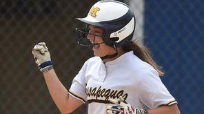 Catherine Capparelli #21, Massapequa left fielder, reacts after