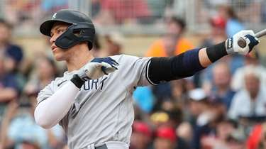 Aaron Judge of the Yankees hits a solo