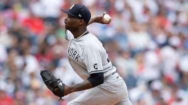 Domingo German of the Yankees throws a pitch