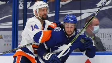 Anthony Cirelli of the Lightning is checked by