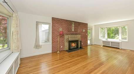 The living/family room has a fireplace.