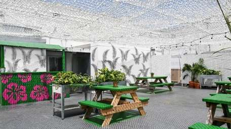 The sheltered outdoor patio space at K Pasa