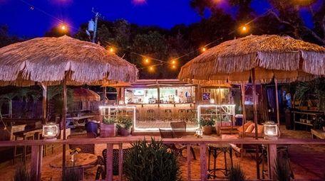 Lynn's Hula Hut, a waterside Tiki bar, is
