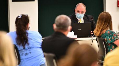 Three Village Deputy Superintendent Jeffrey Carlson speaks during
