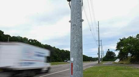 Large steel poles line southbound County Road 51
