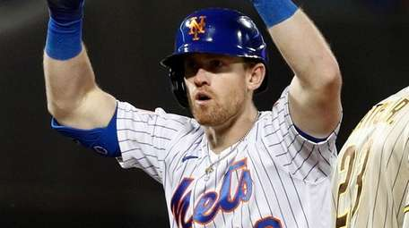 Billy McKinney of the Mets reacts after his