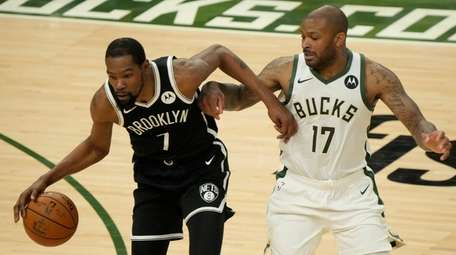 The Nets' Kevin Durant tries to drive past