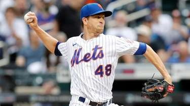 Jacob deGrom of the Mets pitches during the