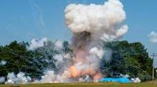 A camper filled with fireworks explodes during a