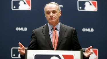Baseball commissioner Rob Manfred speaks to the media