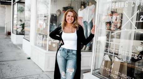 AJ Sunflower Boutique owner Katie Goulding poses outside