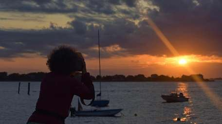 An amateur photographer is photographed while capturing the