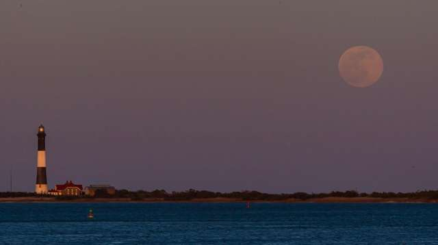 A full moon rises on the night of