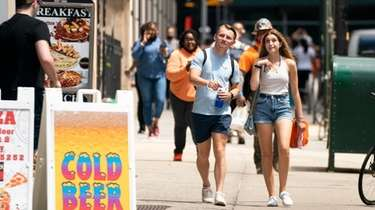 People walk in Lower Manhattan on Tuesday after
