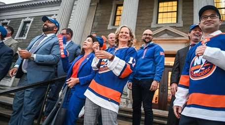 Nassau County Executive Laura Curran hands out Islanders