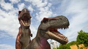 More than 40 animatronic dinosaurs stood at the