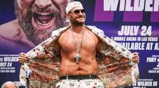 Tyson Fury interacts with the crowd during the