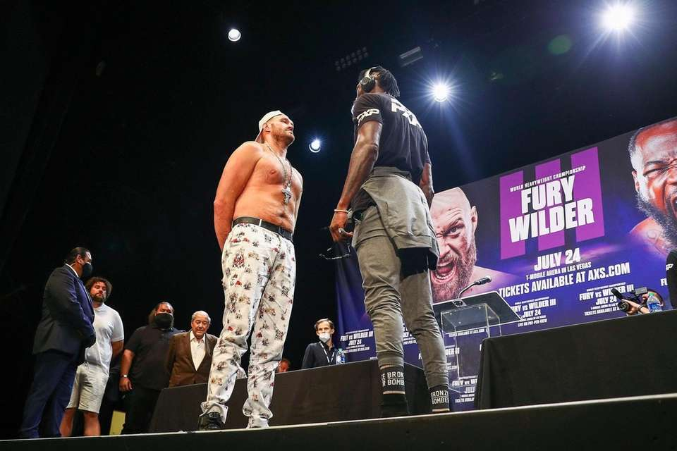Tyson Fury and Deontay Wilder face off during