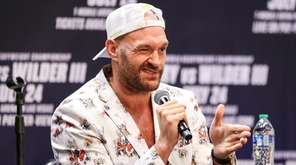 Tyson Fury speaks at the press conference with