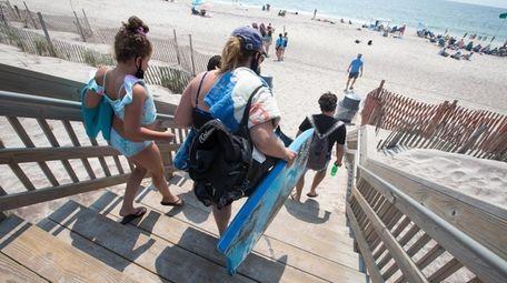 Visitors arrive at the beach in Ocean Beach,