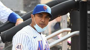Mets manager Luis Rojas look on from the