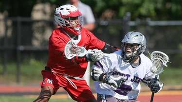Port Jefferson's Kyle Scandale (2) looks to get