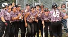 The Mepham softball team runs from the dugout