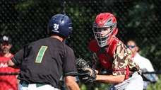 Patchogue-Medford catcher Brian Frascogna makes the easy out