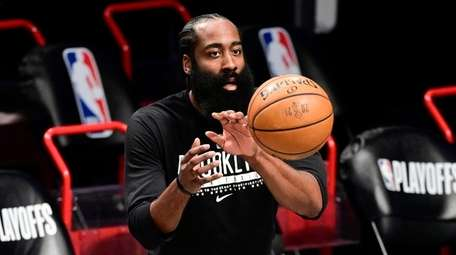 James Harden #13 of the Nets warms up