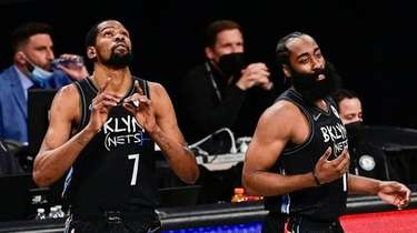 Kevin Durant #7 and James Harden #13 of