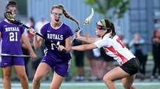 Port Jefferson's Katelynn Johnston drives to the net