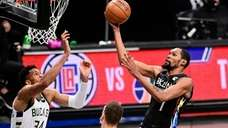 Kevin Durant #7 of the Nets scores a