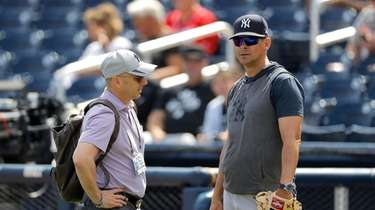 Brian Cashman, left, general manager of the Yankees,