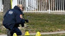 Nassau County crime scene investigators probe shell casings