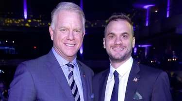 Boomer Esiason and Gunnar Esiason attend the Samsung