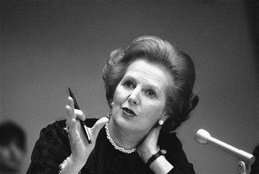 Britain's Prime Minister Margaret Thatcher answers a reporter's