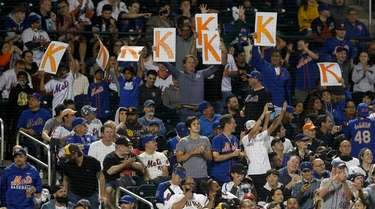 Fans cheer a strikeout during a game between