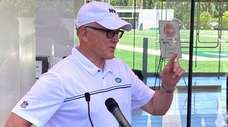 Jets owner and chairman Woody Johnson speaks to