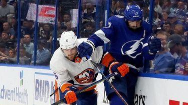 Ryan Pulock #6 of the Islanders checks Alex